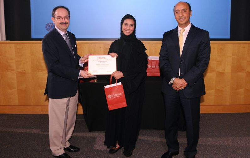 Jawaher Al-Sulaiti of American School of Doha, one of four winners of WCM-Q's Healing Hands essay contest, with Dr. Marco Ameduri, left, and Dr. Rachid Bendriss.