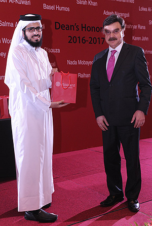 Nasser Al-Kuwari receiving his commemorative gift from Dr. Javaid Sheikh.