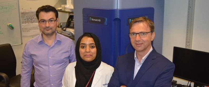 WCM-Q researchers Dr. Rudolf Engelke, left, Hina Sarwath and Dr. Frank Schmidt with the new Olink equipment.
