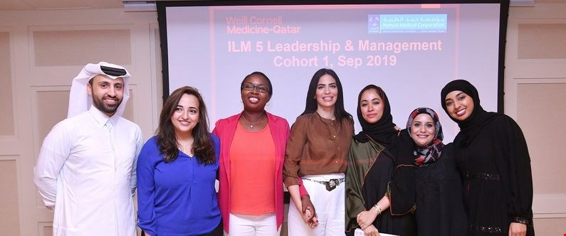 WCM-Q's Director of Alumni Affairs, Haya Ahmad (center) with WCM-Q alumni who completed the leadership and management course.