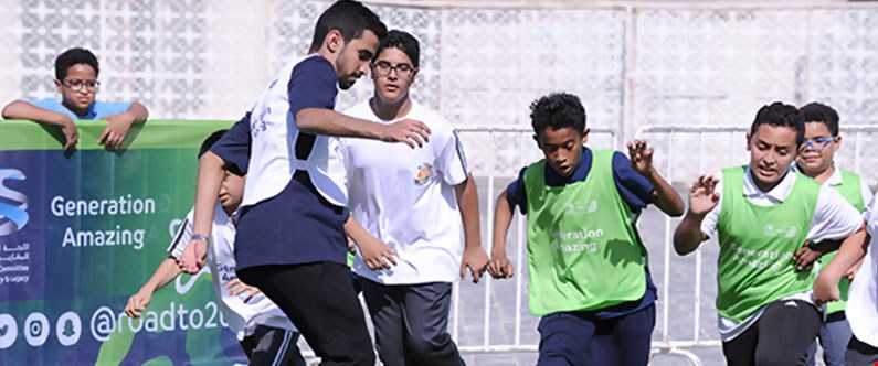 Professional footballer Abdulla Afifa plays a game with some of the visiting schoolchildren.