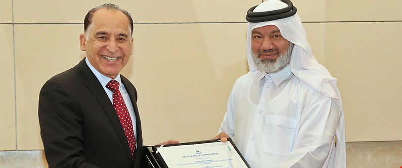 Dr. Ravinder Mamtani received a certificate of appreciation following his talk at Qatar Petroleum.