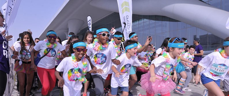 More than 8,000 people participated in the 'happiest 5k on the planet'.