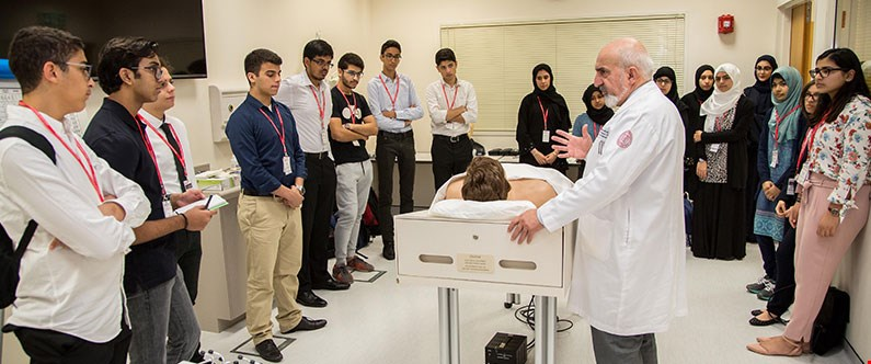 Dr. Mohamud Verjee, associate professor of family medicine in clinical medicine, discusses the human body using one of WCM-Q's state-of-the-art medical mannequins.