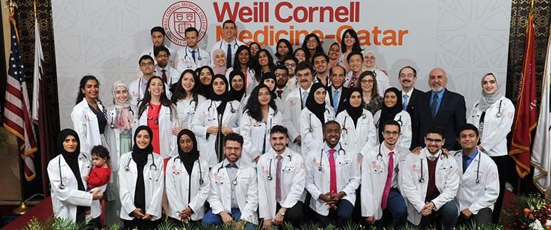 Dr. Javaid Sheikh, dean of WCM-Q, faculty members, and the Class of 2021 with their white coats and stethoscopes.
